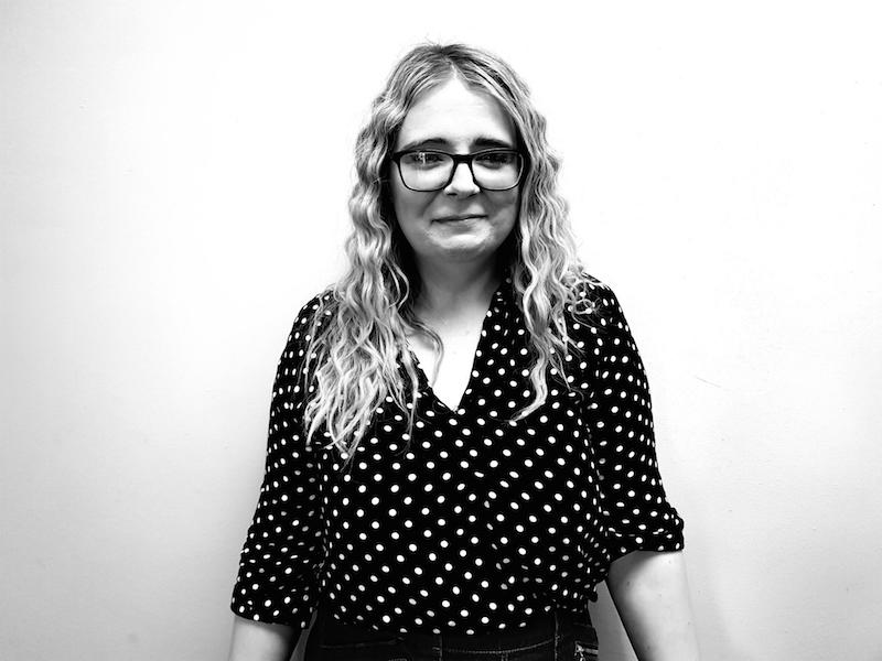 A black and white photo of Chelsea Cummings sales manager of the Richmond & Barnes Magazine