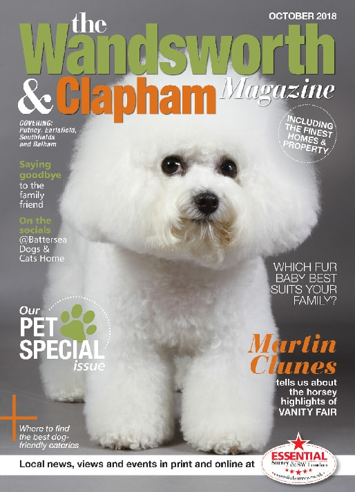 An image of an adorable little white terrier on the front cover of the Wandsworth & Clapham Magazine